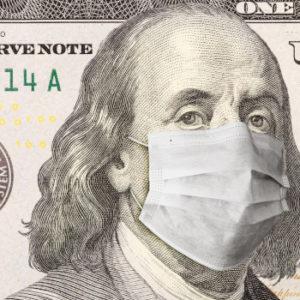 Ob Benjamin Franklin das für möglich gehalten hätte? Die Welt befindet sich ganz im Zeichen der Maske. So auch die Anlagemärkte. Foto: Andy Dean – stock.adobe.com